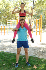 Girl sitting on shoulders of father