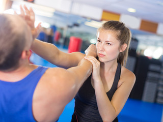 Attractive female is fighting with trainer