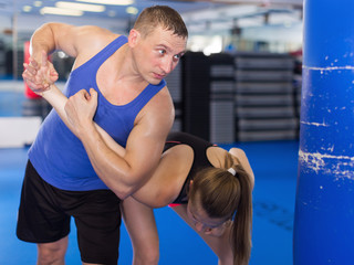 Active woman and her trainer are training captures