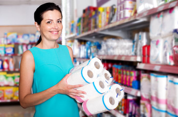 Female in the supermarket holding toilet paper