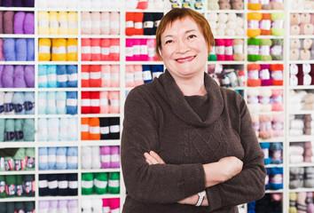 Closeup portrait of smiling mature female in shop
