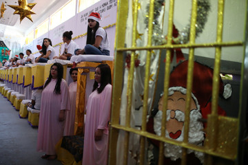 """Prisoners take part in a biblical play inside their prison cell during a Christmas decorating event """"Bright prison cell"""" at the Nelson Hungria prison in Rio de Janeiro"""