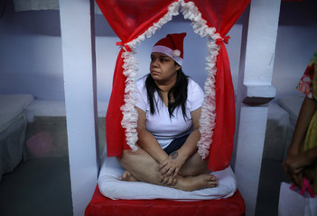 """A prisoner takes part in a biblical play inside a prison cell during a Christmas decorating event """"Bright prison cell"""" at the Nelson Hungria prison in Rio de Janeiro"""