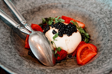 Burrata cheese with seaweed caviar and fruits, toned