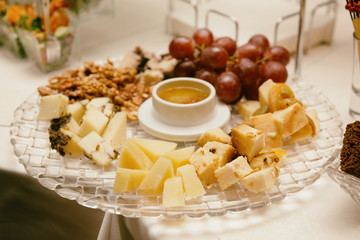 Cheese platter on banquet table, toned