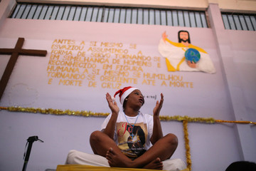 """A prisoner takes part in a biblical play inside her prison cell during a Christmas decorating event """"Bright prison cell"""" at the Nelson Hungria prison in Rio de Janeiro"""