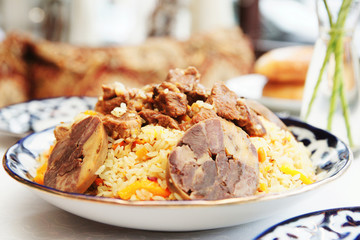 Traditional pilaf in plate, toned