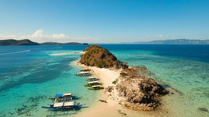 Aerial view of tropical beach on the island, Philippines. Beautiful tropical island with sand beach, palm trees. Tropical landscape: beach with palm trees. Seascape: Ocean, sky, sea. 4K video.