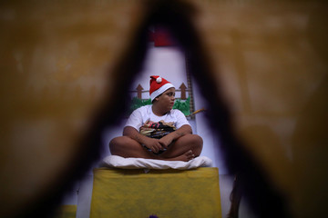 """A prisoner takes part in a biblical play inside their prison cell during a Christmas decorating event """"Bright prison cell"""" at the Nelson Hungria prison in Rio de Janeiro"""