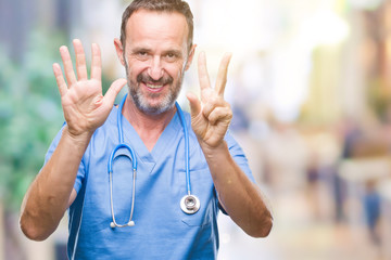 Middle age hoary senior doctor man wearing medical uniform over isolated background showing and pointing up with fingers number seven while smiling confident and happy.
