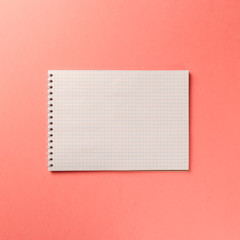 Blank notebook on Coral background. Top view. Flat lay. Copy space. Colorful background. Living Coral color of the Year 2019
