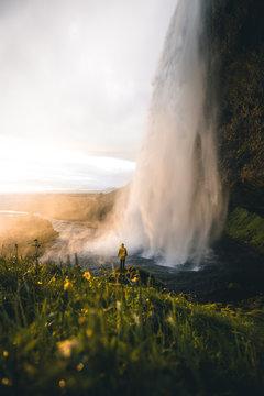 Person walking along a waterfall