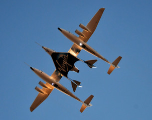 Virgin Galactic's carrier airplane WhiteKnightTwo carrying space tourism rocket plane SpaceShipTwo takes off