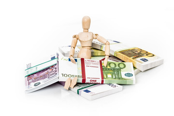 Wooden figurine and euro money
