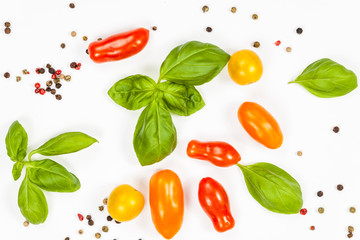 Basil, pepper and cherry tomatoes composition, isolated on white background