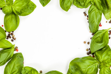 Basil and pepper frame with circular copy space, on white background