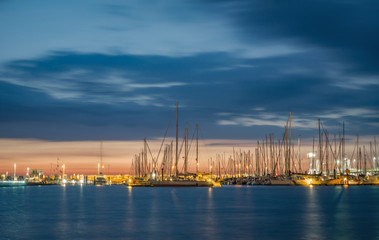 Yacht harbor of Cuxhaven Germany at sunset with water reflections.