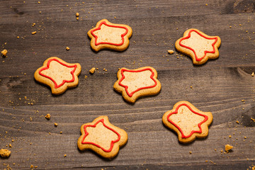 Christmas gingerbread cookies with frosting isolated on wooden background