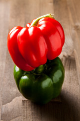 Fresh bell pepper isolated on dark wooden cutting board
