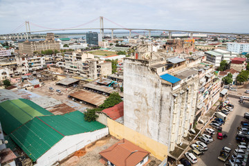 The under construction bridge across the Maputo Bay from Maputo to Katembe (Ponte de Maputo a Katembe), seen over high-rise buildings and streets of Maputo city centre, Southern Mozambique, Africa.