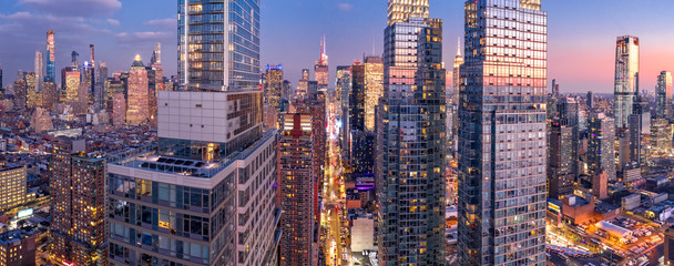 Wall Mural - Aerial view of New York City skyscrapers at dusk as seen from above the 42nd street canyon