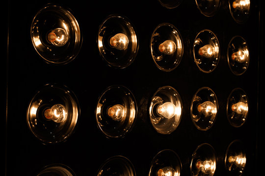 Vintage electric bright golden incandescent bulbs in retro style on a black background. Close-up