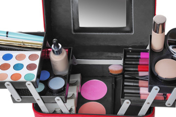 Stylish case with makeup products and beauty accessories on white background, closeup