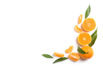 Composition with tangerines and leaves on white background, top view. Space for text