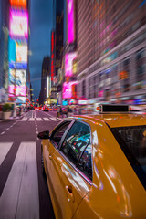 New york yellow cab under bright lights of Times Square