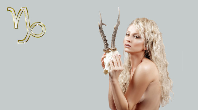 Capricorn Zodiac Sign. Astrology and horoscope concept, Beautiful woman with horns