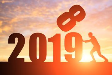 silhouette of businessman push 2019