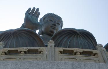 Closeup horizontal photo of Tian Tan Buddha, Lantau Island, Hong Kong. copy space in sky above buddha.