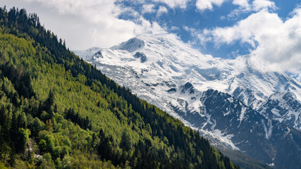 when spring meets winter. landscape of the french alps from Chamonix with green and snowy mountains