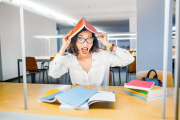 Crazy woman trying to pass through difficult exam