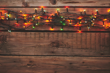 Christmas garland on wooden background with copy space.