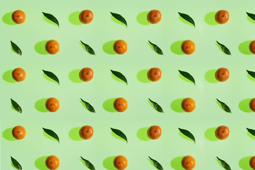 Tangerine pattern with leaves on a lime color background in high resolution