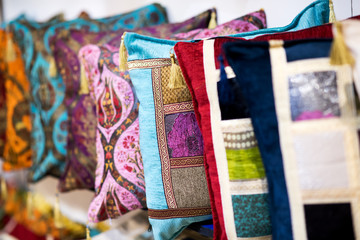 Row of colorful hand-made pillows