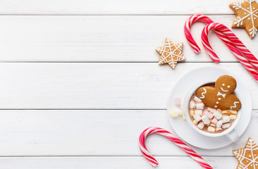 New Year gingerbread in cup of coffee on white background