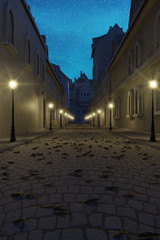 3d rendering of old town with lantern row and cobblestone street at night