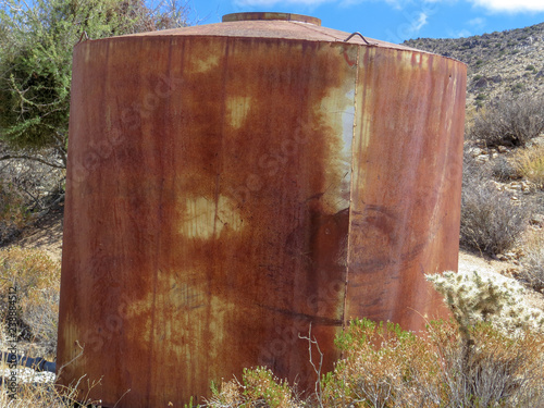 Rusted out water tank decaying in the desert