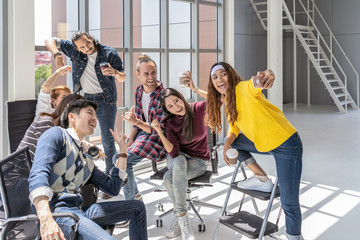 Group Of Asian and Multiethnic Business people with casual suit having selfie together between working in happy action in the modern workplace, people business group concept