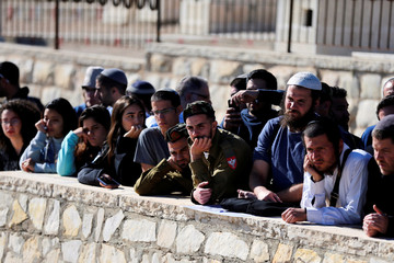Relatives and friends of Israeli soldier Yossi Cohen, who was killed by Palestinian gunman in Israeli-occupied West Bank, attend his funeral in Jerusalem