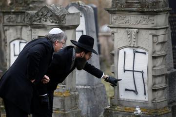 Strasbourg's Grand Rabbi Weill inspects graves desecrated with swastikas in the Jewish cemetery of Herrlisheim