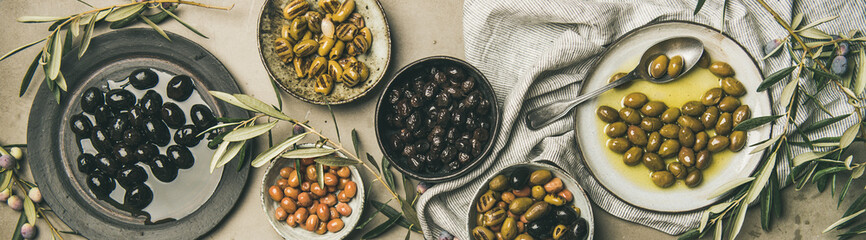 Mediterranean pickled olives and olive tree branches, wide composition Wall mural