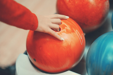 Female hand and bowling ball