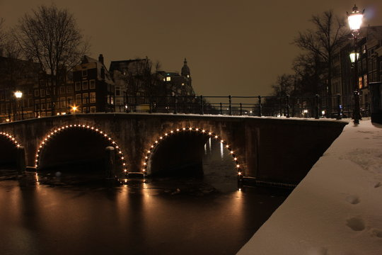 Amsterdam covered in snow at night