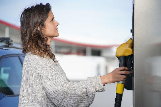 Brunette at gas station