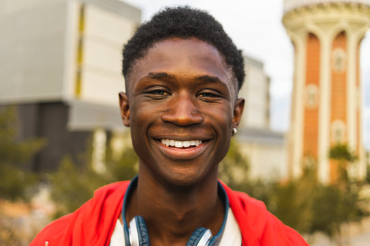 Young black man with headphones, smiling, portrait