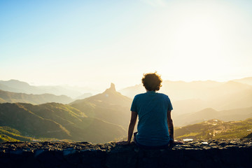 Spain, Canary Islands, Gran Canaria, back view of man watching mountain landscape