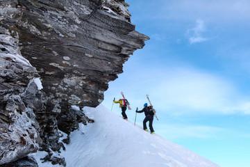 Two men doing a ski tour in Faragas mountains, Southern Carpathians, Romania